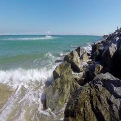 Rocks Of The Wavebreaker In The Sea Stock Footage