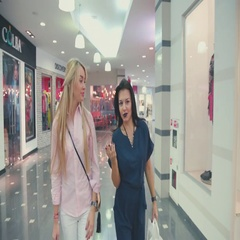 Two friends spend their time at the mall. Shopping girls Stock Footage