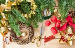 Crafting an advent wreath with golden ornaments Kuvituskuvat