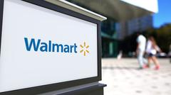 Street signage board with Walmart logo. Blurred office center and walking people Piirros
