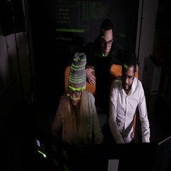 Team of multiethnic IT professionals working with computers in dark, hacking Stock Footage