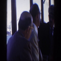 1951: three men engaged in a serious conversation inside a restaurant CUBA Stock Footage
