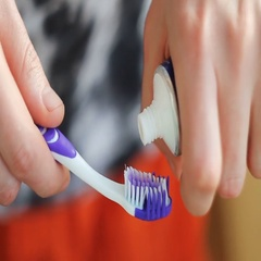 Man squeezing toothpaste on the brush Stock Footage