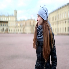 Woman look around old Gatchina Palace square, inquisitive tourist girl portrait Stock Footage