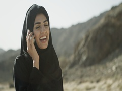 Arab woman talking on mobile. Stock Footage