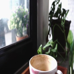 Lipstick symbolic on a white cup beside window, slow motion Stock Footage