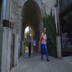 Tourists are retired people are walking into the castle's courtyard Stock Footage