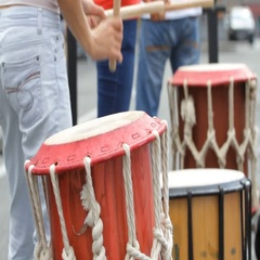 Street musician playing drums wooden drumsticks Stock Footage
