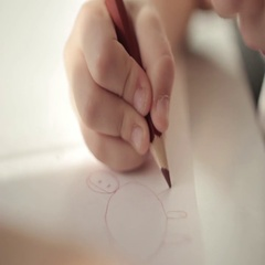 Little girl drawing a picture on the table Stock Footage