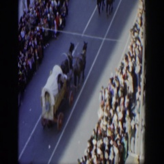 1951: ceremonial parade with horse pulling carts progressing amid larger Stock Footage