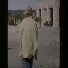 1951: random people walking in high amounts of wind. TEXAS Stock Footage