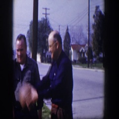 1954: a family is playing ball standing in the front yard tossing the ball  Stock Footage