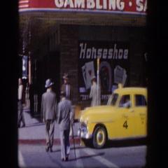 1954: people walking down the street next to a gambling establishment LAS VEGAS Stock Footage