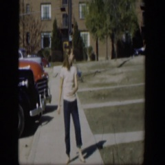 1954: a young girl performs a tap dancing routine on the sidewalk NEVADA Stock Footage