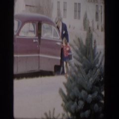 1954: a father brings a dish to neighbor's house with his daughter NEVADA Stock Footage