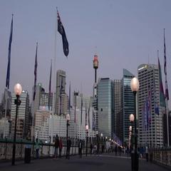Pyrmont Bridge Darling Harbour at dusk in Sydney Australia Stock Footage