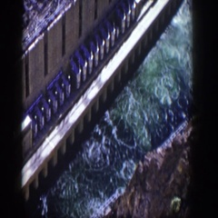 1954: aerial view of a dam with raging water running between the massive rocks Stock Footage