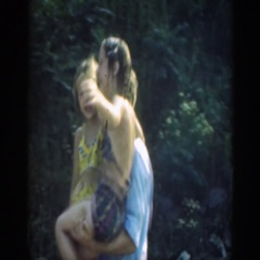 1947: father with daughters cute scene holding and walking mother drying up Stock Footage