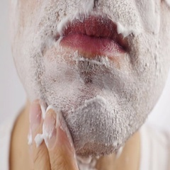 Man shaves his face. Stock Footage