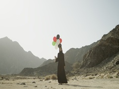 Arab woman holding balloons. Stock Footage