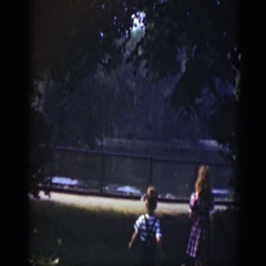 1948: children running over to a lake. WASHINGTON DC Stock Footage