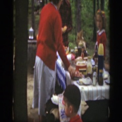 1949: family outside enjoying each others company and eating a variety of food Stock Footage