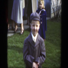 1949: a boy wearing a coat and hat while shaking his head no MASSACHUSETTS Stock Footage