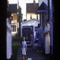1949: boy pushes wagon around family MASSACHUSETTS Stock Footage
