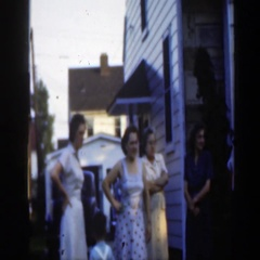 1949: family gathers in back yard on summer day MASSACHUSETTS Stock Footage