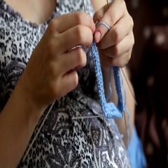 Pregnant woman crocheting for baby during pregnancy. Crochet, knitting process Stock Footage