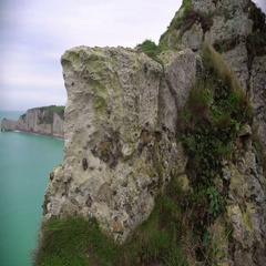 White chalk cliff covered with grass, view on rocks and sea from mountain top Stock Footage