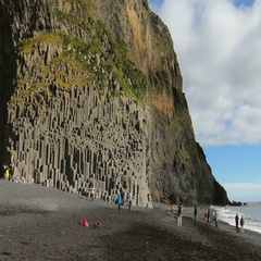 Famous basalt rocks on black sand beach Reynisfjara in Iceland,in sunny fall Stock Footage