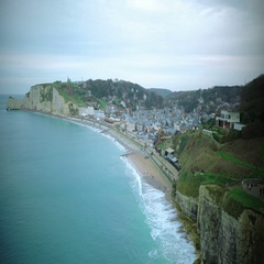 Etretat coastline, view on town from mountain top, famous resort place in France Stock Footage
