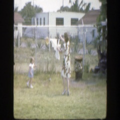 1945: spunky toddler helping mom with the laundry. FLORIDA Stock Footage