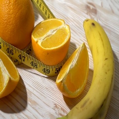 Oranges, juice, dumbbells and measuring tape on wooden background. Stock Footage