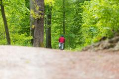Cyclist Riding Bycicle on Forest Trail. Stock Photos