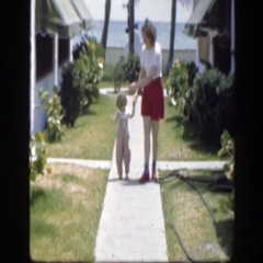 1945: mother holding her child, walking on the sidewalk. FLORIDA Stock Footage