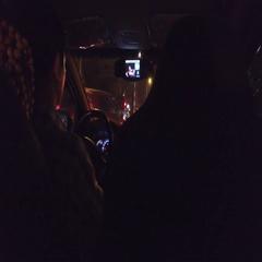 Uber passenger checks app at night in Vietnam Stock Footage
