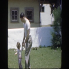 1945: strong father and cute kid walking on the ground and father caresses her Stock Footage