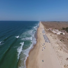 Aerial. Flying over beach of Barril, with the sky in the summer. Tavira Portugal Stock Footage