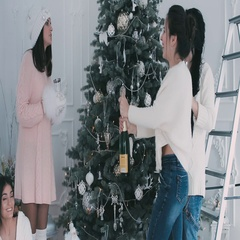 Girls poured champagne near a Christmas tree Stock Footage