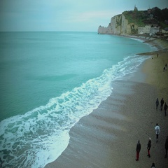 People walking on beach and enjoying view on English Channel, Etretat coast Stock Footage
