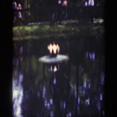 1948: people standing around a large pond with something in the center of it Stock Footage