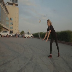 Girl and men dancing strip plastic on street stock footage video Stock Footage