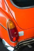 Bright Orange back of an antique restored automobile Stock Photos