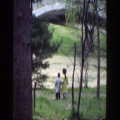 1949: little boy and little girl walking in the woods down a hill. CINCINNATTI Stock Footage