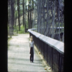 1949: little boy walking outside on a bridge. CINCINNATTI OHIO Stock Footage