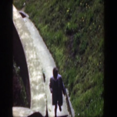 1949: little boy walking up the steps in the sunshine. CINCINNATTI OHIO Stock Footage