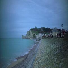 Evening promenade, people walking on embankment and enjoying weekend in Etretat Stock Footage