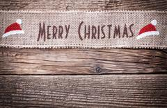 Merry Christmas sign on wooden background with copy space Stock Photos